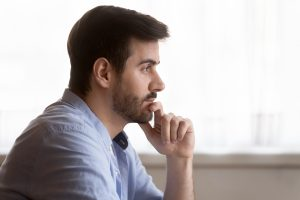 man with depression symptoms listens closely in depression treatment in Greenwood, IN at Renewed Hope counseling services 46143