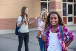 confident teen girl at school. She went to teen counseling in greenwood, in at renewed hope counseling 46143