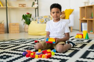 boy playing with blocks during a therapy session with his child therapist at Renewed Hope Counseling Services. Out child therapists also offer play therapy in child therapy. Begin child therapy in Greenwood, IN 46143
