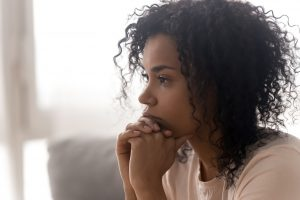 sad african american woman suffering from depression and anxiety. She gets counseling in Greenwood, IN to overcome these struggles and find support