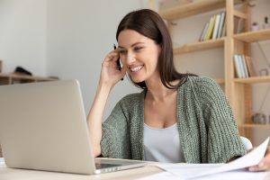 happy woman meets with her online counselor during online counseling in Indiana to overcome anxiety, depression, PTSD, and more. Get help from Renewed Hope Counseling Services